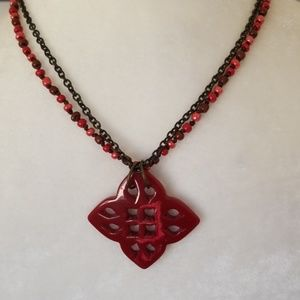 Multi red tone bead and metal necklace